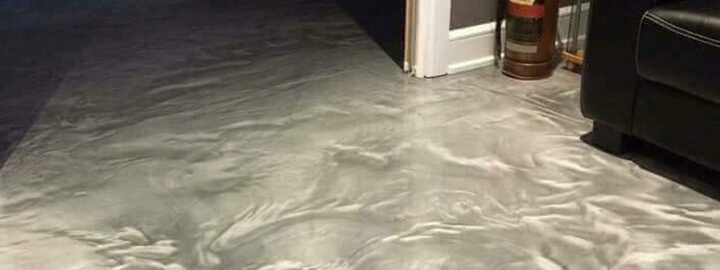 Interior basement floor professionally coated to look like high-end marble